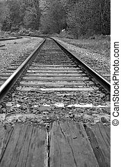 Macro railroad track with black and white image