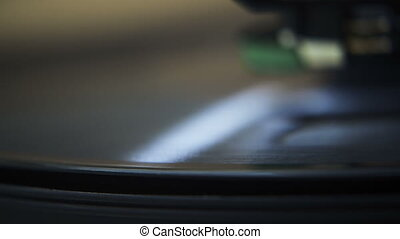 Macro Record Player Spin - Macro close up on the edge of a...