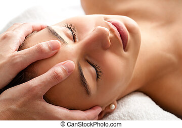 Macro relaxing facial massage. - Close up head shot of Woman...