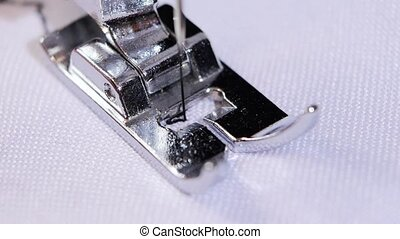 Macro. Sewing needle does figured seam. Slow motion - Macro,...