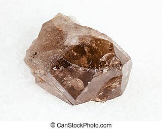 raw smoky quartz crystal on white - macro shooting of ...