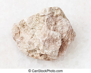 raw marl stone on white - macro shooting of natural mineral...