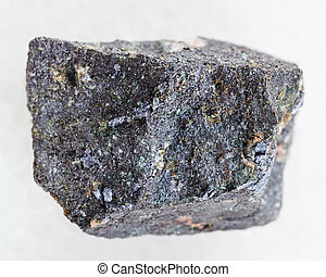 rough Molybdenite stone on white - macro shooting of natural...