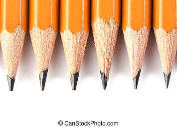 Macro shooting. Yellow pencils isolated on white background. Stationery concept