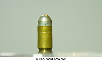 Macro shot of 9 mm handgun Bullet.Rotating on a solid...