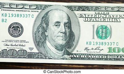 Macro shot of a 100 dollar. Benjamin Franklin as depicted on the bill