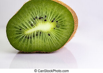 Macro shot of a kiwi slice. Healthy food