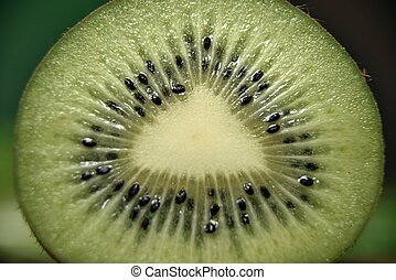 Macro shot of a kiwi Sliced kiwi macro.
