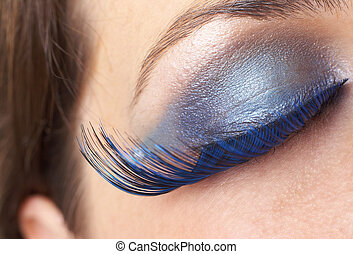 Macro shot of beautiful eyes with bright blue make-up and fake eyelashes. Not a crop. Shallow depth of field