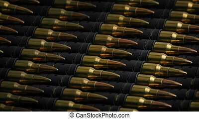 Macro Shot Of Bullet Magazines Rotating - Lots of ammo...
