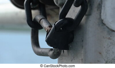 Macro shot of chains on a pier
