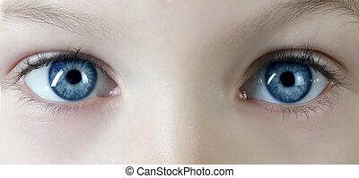 macro shot of children's blue eyes