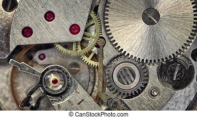 Video 3840x2160 - Clockspring, flywheel and continuous gears comprise the clockwork mechanism that drives a watch. This closeup view demonstrates the physics involved.