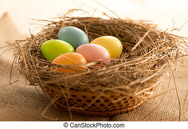Macro shot of colorful Easter eggs lying in nest on the ...