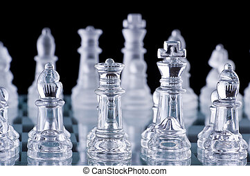 Macro shot of glass chess set against a black background
