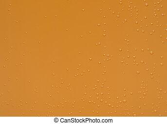 Macro shot of orange effervescent bubbles of calcium and vitamin C effervescent tablets