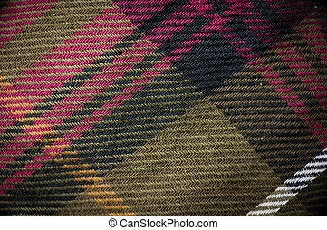 Macro shot of plaid garment - Macro shot of plaid textured...