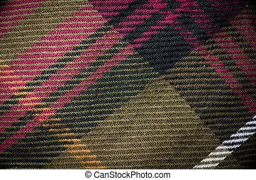 Macro shot of plaid garment - Macro shot of plaid textured...