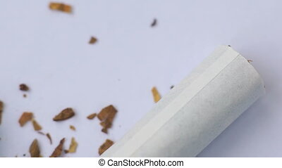Macro shot of tablets and torn cigarettes with tobacco...