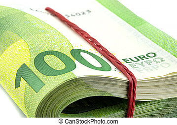 Macro shot of the European Union 100 EURO banknote, stack of banknotes folded in half wrapped with a rubber band, isolated on a white background.