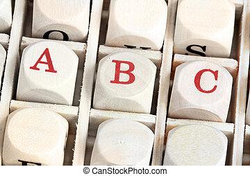 Macro shot of wood alphabet letter blocks