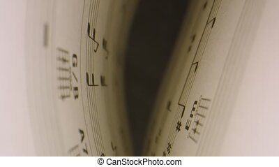 Macro shot through musical notes inside of music book