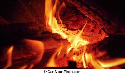 Macro slow motion video of fire flames slowly flowing from ...