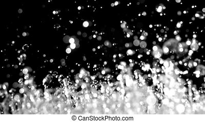 Macro splash effect of huge rain drops. Black background....