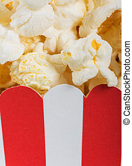 Striped red and white box with popcorn - Macro. Striped red...