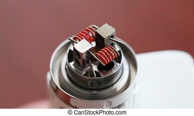 Macro video of burning spiral electronic cigarette