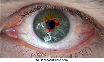 Macro video of human eye with heart sign