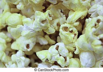 Macro view of fresh buttery popcorn.