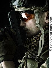 Macro view of military man with gun