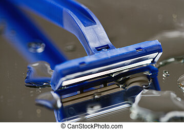 Macro view of safety razor blade on water drops background