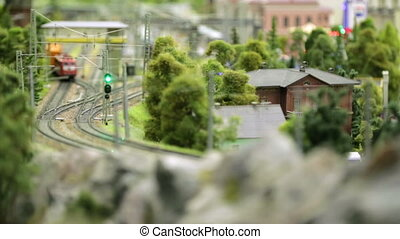 Macro view of toy hobby railroad layout with railway station...