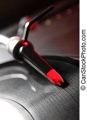 Macro vinyl record playing music