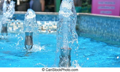 Macro water jet fountain in the park 4k