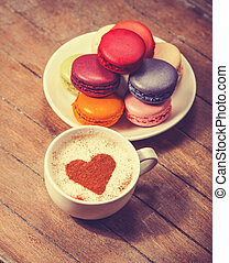 macrons with cup of coffee