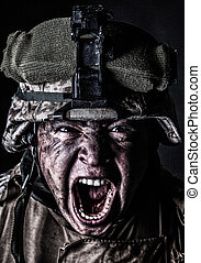 Mad army soldier screaming while looking at camera