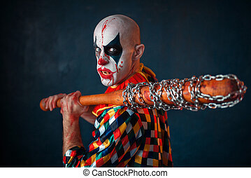 Mad bloody clown with baseball bat