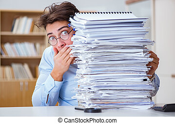 Mad businessman with piles of papers