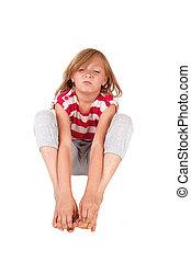 Mad girl sitting on floor.
