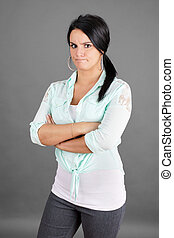 Mad woman or girlfriend with arms crossed looking at camera on grey