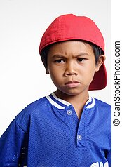 mad kid - young boy in red hat and blue jersey with a mad...