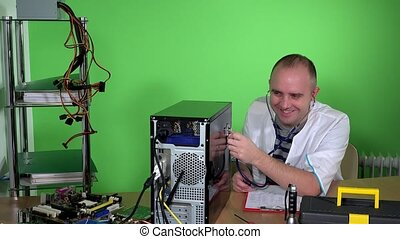 Mad man pc doctor examining computer case with stethoscope and laughing
