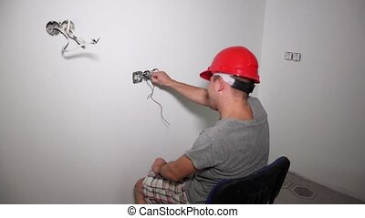 Mad man take wire with bare hand and get electric shock. Guy...