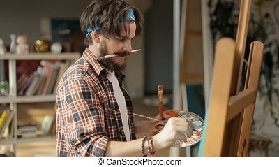 Mad Painter Creates Masterpiece - Mad creative painter with...