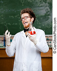 Mad professor laughs handing conical flask