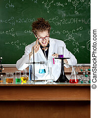 Mad professor shows attention gesture while working in his laboratory