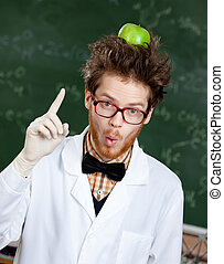 Mad professor with an apple on his head shows forefinger